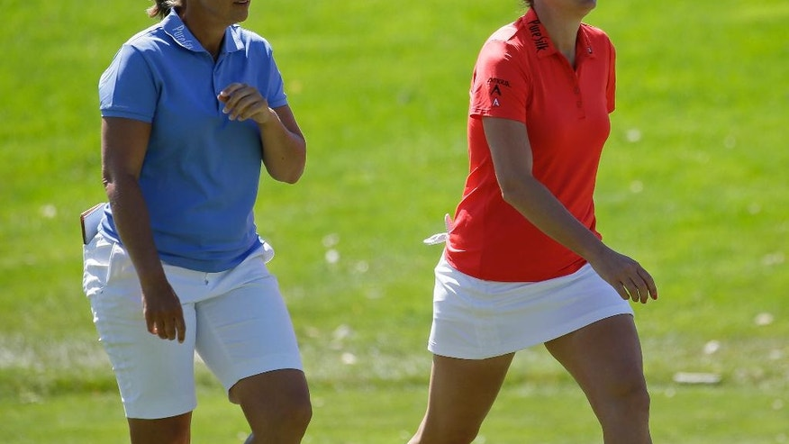Angela Stanford, left, and Brittany Lang, right, walk up to the first green during the final round of the U.S. Women's Open golf tournament at CordeValle, Sunday, July 10, 2016, in San Martin, Calif. (AP Photo/Eric Risberg)