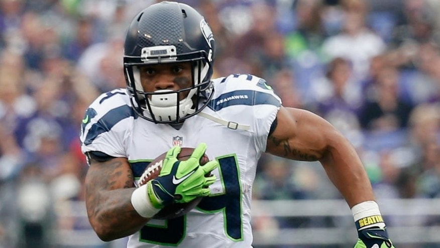 at M&T Bank Stadium on December 13, 2015 in Baltimore, Maryland.,BALTIMORE, MD - DECEMBER 13: Running back Thomas Rawls #34 of the Seattle Seahawks carries the ball in the first half against the Baltimore Ravens at M&T Bank Stadium on December 13, 2015 in Baltimore, Maryland. (Photo by Rob Carr/Getty Images)