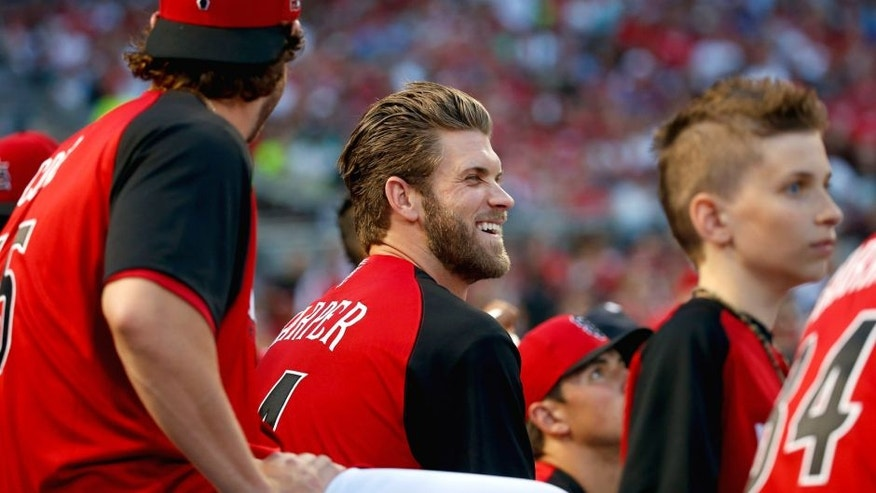 CINCINNATI, OH - JULY 13: National Leauge All-Star Bryce Harper #34 of the Washington Nationals laughs during the Gillette Home Run Derby presented by Head & Shoulders at the Great American Ball Park on July 13, 2015 in Cincinnati, Ohio. (Photo by Rob Carr/Getty Images)