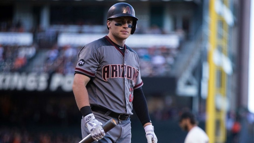 Arizona Diamondbacks' Brandon Drury walks back to the dugout after striking out against San Francisco Giants starting pitcher Madison Bumgarner during the fifth inning of a baseball game on Sunday, July 10, 2016, in San Francisco. (AP Photo/D. Ross Cameron)