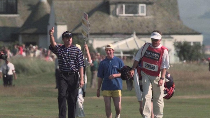 FILE- In this July 20, 1987, file photo, Justin Leonard gives a thumbs-up to the gallery as he walks along the 18th fairway with his caddie in the 126th British Open golf Championship at Royal Troon, Scotland. The British Open is scheduled for July 14–17, 2016, at Royal Troon Golf Club in Ayrshire, Scotland. (AP Photo/Ian Stewart, File)