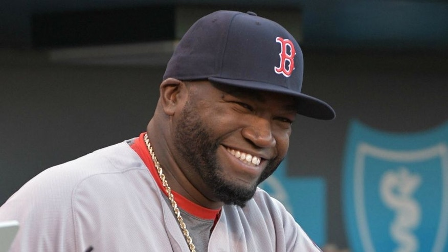 May 17, 2016; Kansas City, MO, USA; Boston Red Sox designated hitter David Ortiz (34) smiles before heading onto the field to be presented with a painting of himself in the World Series and a case of Kansas City barbecue sauces before the game against the Kansas City Royals at Kauffman Stadium. The Royals won 8-4. Mandatory Credit: Denny Medley-USA TODAY Sports