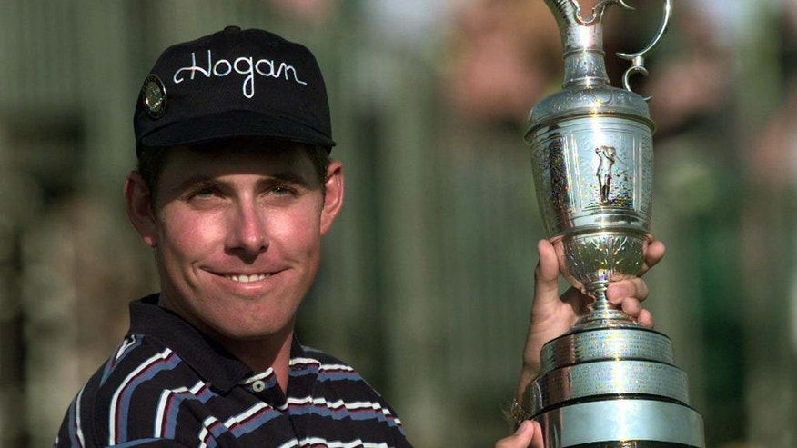 FILE - In this July 20, 1997, file photo, Justin Leonard poses with the Open Trophy on the 18th green at Royal Troon Golf Club in Scotland. For golfers, winning a major championship isn't over with the final putt. Sometimes the most nervous part is giving the victory speech. (AP Photo/Ian Stewart, File)