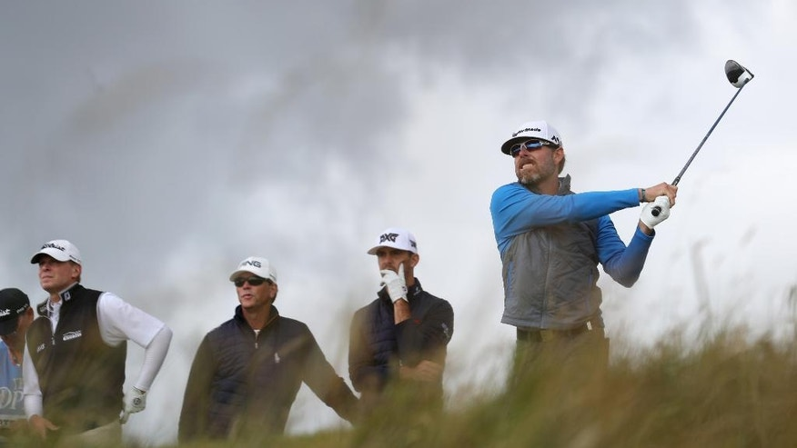 Justin Leonard of the US watches his tee shot from the 6th during a practice round for the British Open Golf Championships at the Royal Troon Golf Club in Troon, Scotland, Tuesday, July 12, 2016. (AP Photo/Peter Morrison)
