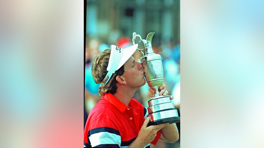 FILE - In this July 23, 1989 file photo, Mark Calcavecchia kisses the Open Golf Championship trophy he won at the Open in Troon, Scotland. For golfers, winning a major championship isn't over with the final putt. Sometimes the most nervous part is giving the victory speech.(AP Photo/Martin Cleaver, File)