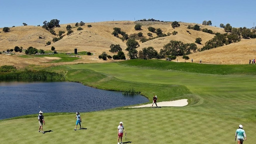 Karrie Webb, center, of Australia, misses a birdie putt on the fifth green during the second round of the U.S. Women's Open golf tournament at CordeValle, Friday, July 8, 2016, in San Martin, Calif. Christina Kim, right, and Ilhee Lee, second from left, of South Korea. (AP Photo/Eric Risberg)