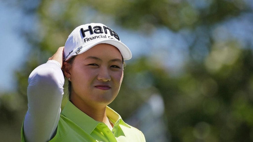 Minjee Lee, of Australia, smiles at cheering fans after hitting from the 10th tee during the second round of the U.S. Women's Open golf tournament at CordeValle, Friday, July 8, 2016, in San Martin, Calif. (AP Photo/Eric Risberg)