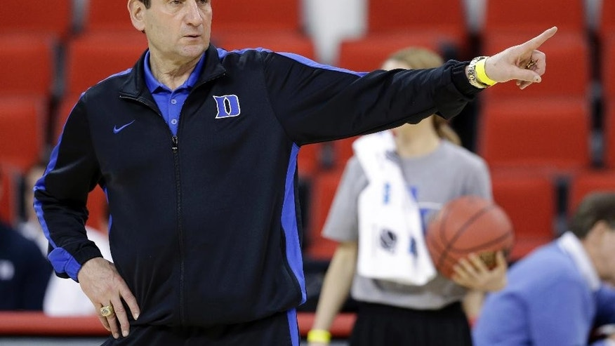March 20, 2014: Duke head coach Mike Krzyzewski directs his team during practice at the NCAA college basketball tournament in Raleigh, N.C.