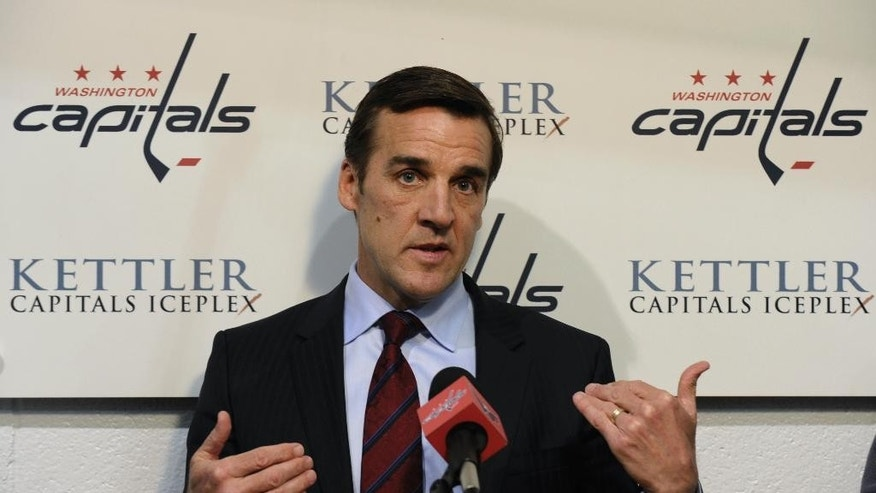 FILE - In this May 15, 2013, file photo, Washington Capitals general manager George McPhee talks with reporters at the Kettler Iceplex in Arlington, Va. A person with direct knowledge of the decision says McPhee has been hired as general manager of the NHL's expansion Las Vegas franchise. The person spoke on condition of anonymity because owner Bill Foley's announcement was set for Wednesday afternoon, July 13, 2016. McPhee most recently served as special advisor to New York Islanders GM Garth Snow. Before that he spent 16 seasons as GM of the Washington Capitals.  (AP Photo/Susan Walsh, FIle)
