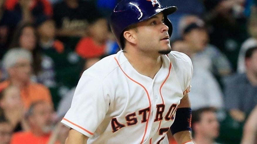 HOUSTON, TX - MAY 04: Jose Altuve #27 of the Houston Astros connects on a two-run double in the fifth inning during their game against the Minnesota Twins at Minute Maid Park on May 4, 2016 in Houston, Texas. (Photo by Scott Halleran/Getty Images)