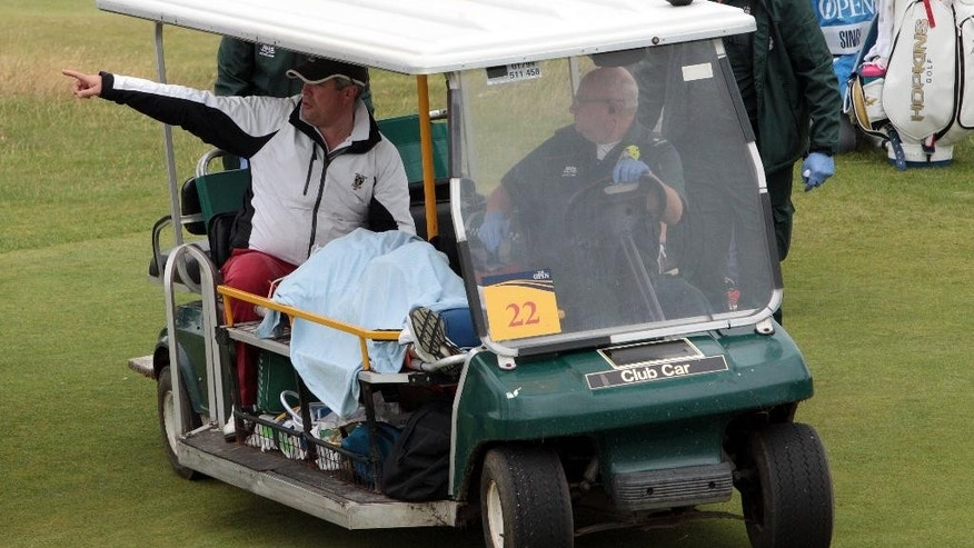 A golf buggy carries William Ciplinski, caddie for Marco Dawson of the U.S, during a practice round ahead of the British Open Golf Championships at the Royal Troon Golf Club in Troon, Scotland, Wednesday, July 13, 2016. Marco Dawson's caddie has been taken to hospital after being hit on the head by a tee shot from Vijay Singh during a practice round at the British Open. (Peter Byrne/PA via AP)
