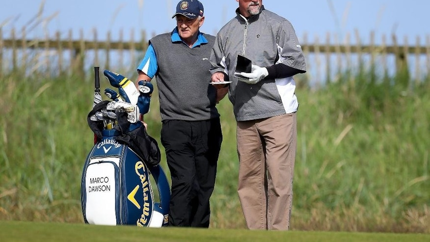 Marco Dawson of the U.S and his caddie William Ciplinski, left, during a practice round ahead of the British Open Golf Championships at the Royal Troon Golf Club in Troon, Scotland, Wednesday, July 13, 2016. Marco Dawson's caddie has been taken to hospital after being hit on the head by a tee shot from Vijay Singh during a practice round at the British Open. (Peter Byrne/PA via AP)