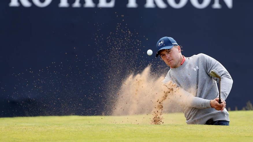 Jordan Spieth of the United States plays out of a sand trap on the 18th green during a practice round ahead of the British Open Golf Championship at the Royal Troon Golf Club in Troon, Scotland, Wednesday, July 13, 2016. The British Open starts Thursday.(AP Photo/Peter Morrison)