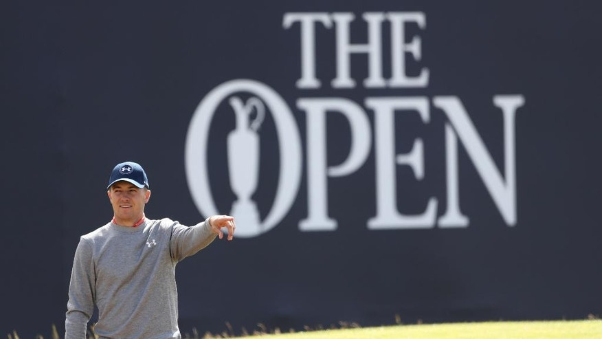 Jordan Spieth of the United States points as he gets ready to play out of a sand trap on the 18th green during a practice round ahead of the  British Open Golf Championship at the Royal Troon Golf Club in Troon, Scotland, Wednesday, July 13, 2016. The British Open starts Thursday. (AP Photo/Peter Morrison)