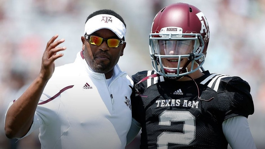 COLLEGE STATION, TX - APRIL 13: Head coach Kevin Sumlin of the Texas A&M Aggies chats with his quarterback Johnny Manziel #2 before the Maroon & White spring football game at Kyle Field on April 13, 2013 in College Station, Texas. (Photo by Scott Halleran/Getty Images)