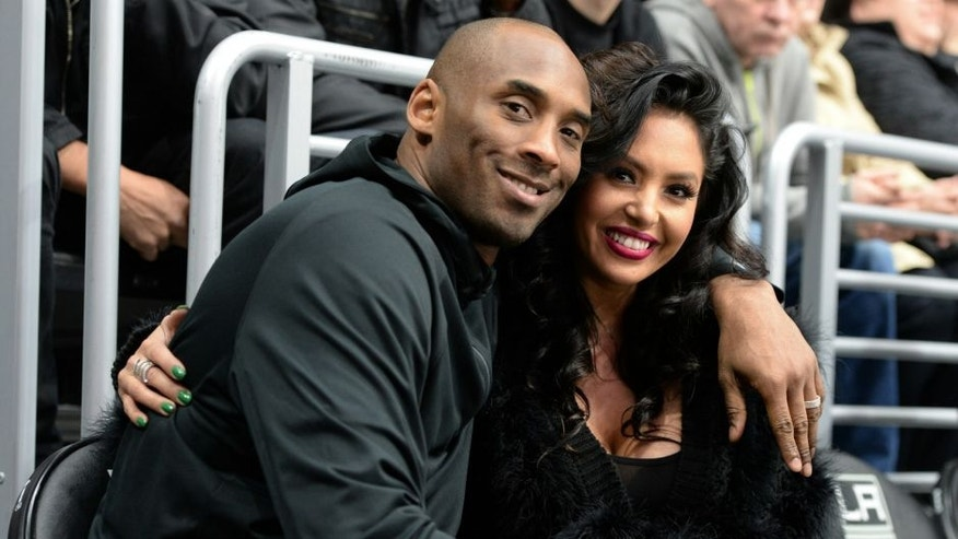 LOS ANGELES, CA - MARCH 09: Los Angeles Lakers Guard Kobe Bryant and his wife Vanessa Bryant pose for a photo during a game between the Los Angeles Kings and the Washington Capitals at STAPLES Center on March 09, 2016 in Los Angeles, California. (Photo by Andrew D. Bernstein/NHLI via Getty Images) *** Local Caption ***