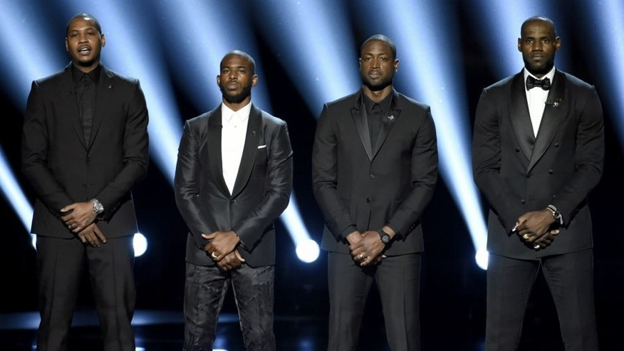 NBA basketball players Carmelo Anthony, from left, Chris Paul, Dwyane Wade and LeBron James speak on stage at the ESPY Awards at the Microsoft Theater on Wednesday, July 13, 2016, in Los Angeles. (Photo by Chris Pizzello/Invision/AP)