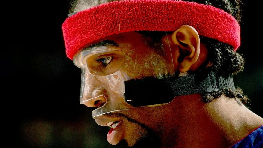 PHILADELPHIA - MAY 1: Richard Hamilton #32 of the Detroit Pistons is seen wearing his protective mask during Game four of the Eastern Conference Quarterfinals against the Philadelphia 76ers on May 1, 2005 at the Wachovia Center in Philadelphia, Pennsylvania. The Pistons won 97-92 in overtime. NOTE TO USER: User expressly acknowledges and agrees that, by downloading and or using this photograph, User is consenting to the terms and conditions of the Getty Images License Agreement. Mandatory Copyright Notice: Copyright 2005 NBAE (Photo by Jesse D. Garrabrant/NBAE via Getty Images)