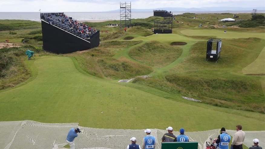 Jason Dufner of the US plays of the 8th tee, the hole a par 3, is 123 yards long and known as the 'postage stamp' during a practice round for the British Open Golf Championships at the Royal Troon Golf Club in Troon, Scotland, Tuesday, July 12, 2016. The Open Starts Thursday. (AP Photo/Peter Morrison)