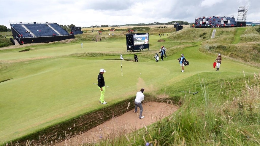 Thongchai Jaidee of Thailand plays out of a sand trap on the 8th green, the hole a par 3, is 123 yards long and known as the 'postage stamp' during a practice round for the British Open Golf Championships at the Royal Troon Golf Club in Troon, Scotland, Tuesday, July 12, 2016. The Open starts Thursday .(AP Photo/Peter Morrison)