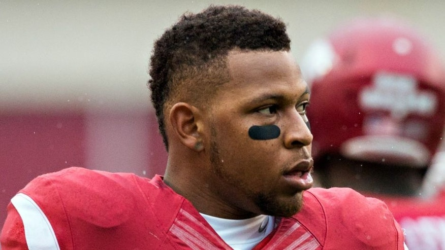 <p>FAYETTEVILLE, AR - NOVEMBER 22: Jonathan Williams #32 of the Arkansas Razorbacks warming up before a game against the Ole Miss Rebels at Razorback Stadium on November 22, 2014 in Fayetteville, Arkansas. The Razorbacks defeated the Rebels 30-0. (Photo by Wesley Hitt/Getty Images)</p>
