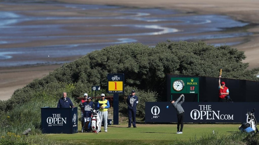 Rory McIlroy of Northern Ireland tees off the 1st during the first round of the British Open Golf Championship at the Royal Troon Golf Club in Troon, Scotland, Thursday, July 14, 2016. (AP Photo/Peter Morrison)