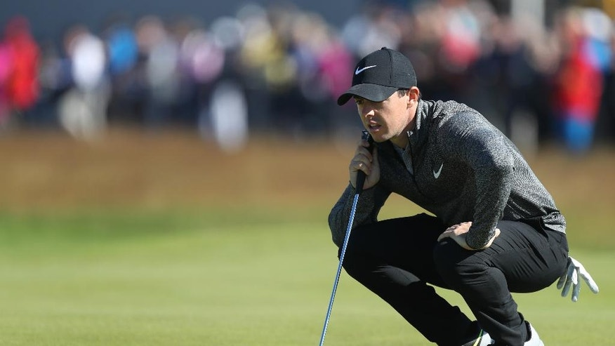 Rory McIlroy of Northern Ireland looks at his put on the first green during the first round of the British Open Golf Championship at the Royal Troon Golf Club in Troon, Scotland, Thursday, July 14, 2016. (AP Photo/Peter Morrison)