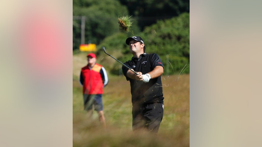 Patrick Reed of the US plays out of the heavy rough on the 12th fairway during the first round of the British Open Golf Championship at the Royal Troon Golf Club in Troon, Scotland, Thursday, July 14, 2016. (AP Photo/Ben Curtis)
