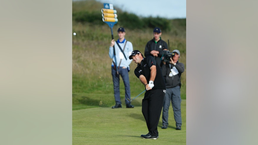 Patrick Reed of the United States plays from the 4th fairway during the first round of the British Open Golf Championship at the Royal Troon Golf Club in Troon, Scotland, Thursday, July 14, 2016. (AP Photo/Ben Curtis)