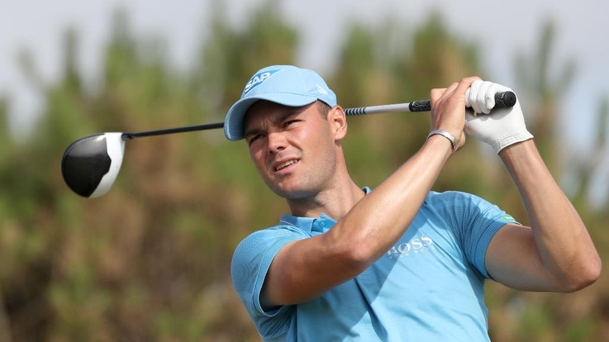 Martin Kaymer of Germany plays his tee shot off the 13th tee the first round of the British Open Golf Championship at the Royal Troon Golf Club in Troon, Scotland, Thursday, July 14, 2016. (AP Photo/Peter Morrison)
