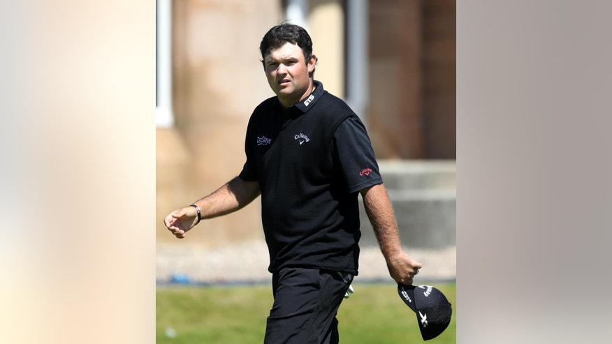 Patrick Reed of the United States looks towards spectators as he walks off the 18th green after completing his first round of the British Open Golf Championship at the Royal Troon Golf Club in Troon, Scotland, Thursday, July 14, 2016. (AP Photo/Peter Morrison)