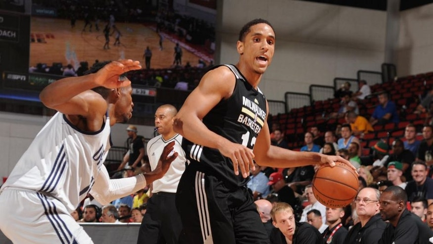 LAS VEGAS, NV - JULY 13: Malcolm Brogdon #13 of Milwaukee Bucks defends the ball against the Dallas Mavericks during the 2016 Las Vegas Summer League on July 13, 2016 at the Cox Pavillon in Las Vegas, Nevada. NOTE TO USER: User expressly acknowledges and agrees that, by downloading and or using this Photograph, user is consenting to the terms and conditions of the Getty Images License Agreement. Mandatory Copyright Notice: Copyright 2016 NBAE (Photo by Bart Young/NBAE via Getty Images)