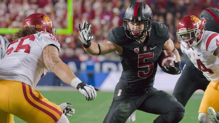 SANTA CLARA, CA - DECEMBER 5: Christian McCaffrey #5 of the Stanford Cardinal runs with the ball during the Pac-12 Championship Game against the USC Trojans played on December 5, 2015 at Levi's Stadium in Santa Clara, California. Visible at left is Anthony Sarao #56 of USC. (Photo by David Madison/Getty Images)