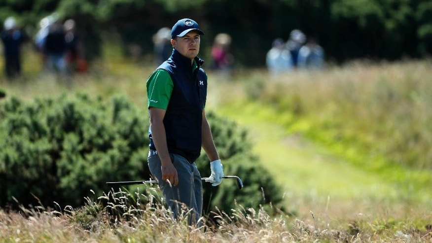Jordan Spieth of the United States looks to see where his ball has landed after playing out of the rough on the edge of the 11th green during the first round of the British Open Golf Championship at the Royal Troon Golf Club in Troon, Scotland, Thursday, July 14, 2016. (AP Photo/Ben Curtis)