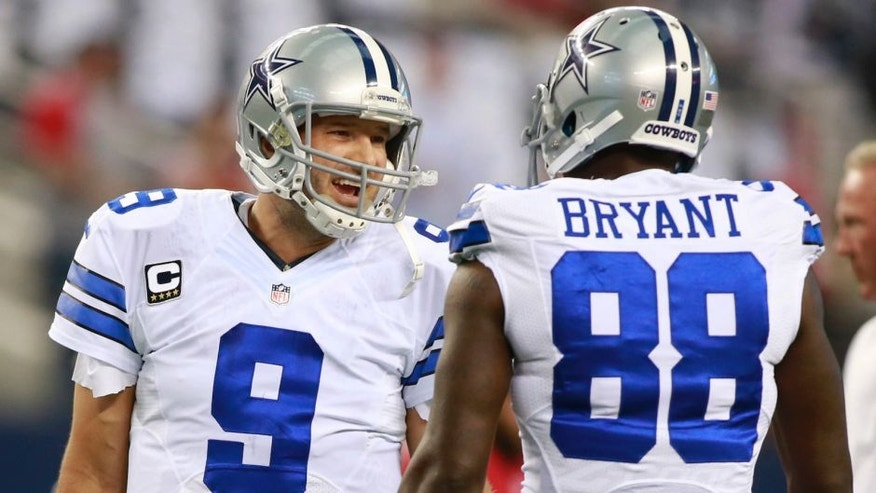 Sep 7, 2014; Arlington, TX, USA; Dallas Cowboys quarterback Tony Romo (9) talks with wide receiver Dez Bryant (88) before the game against the San Francisco 49ers at AT&T Stadium. Mandatory Credit: Tim Heitman-USA TODAY Sports