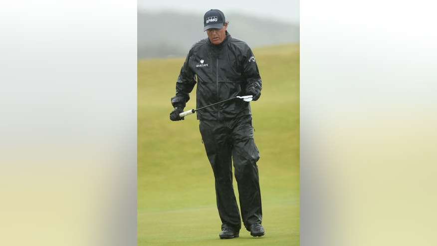 Phil Mickelson of the United States walks forward after putting on the 16th green during the second round of the British Open Golf Championships at the Royal Troon Golf Club in Troon, Scotland, Friday, July 15, 2016. (AP Photo/Peter Morrison)