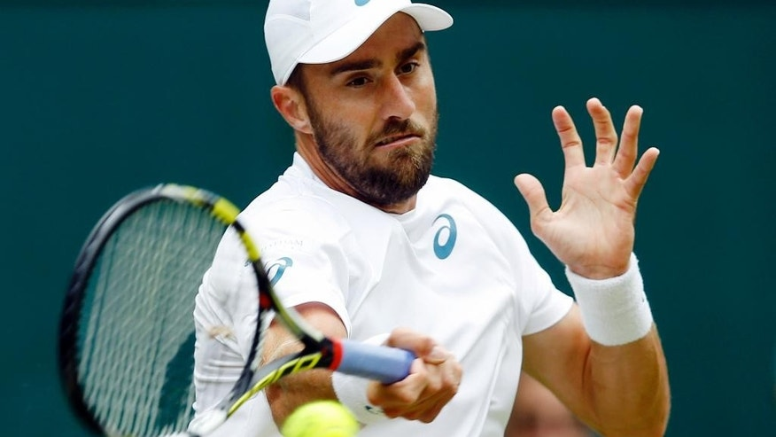 FILE - In this July 4, 2016, file photo, Steve Johnson, of the United States, returns to Roger Federer, of Switzerland, during their men's singles match in the Wimbledon Tennis Championships in London. Johnson had his appeal approved by the International Tennis Federation's Olympic Committee to compete at next month's Rio Games. (AP Photo/Kirsty Wigglesworth, File)