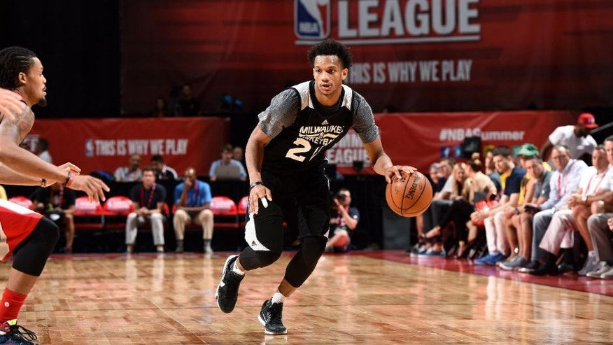 <p>Rashad Vaughn of Milwaukee Bucks handles the ball during the game against the Houston Rockets during the 2016 Las Vegas Summer League.</p>