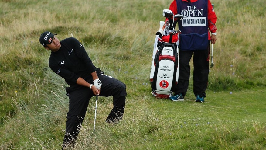 Hideki Matsuyama of Japan hits out of the rough onto the 8th green during the second round of the British Open Golf Championship at the Royal Troon Golf Club in Troon, Scotland, Friday, July 15, 2016. (AP Photo/Ben Curtis)