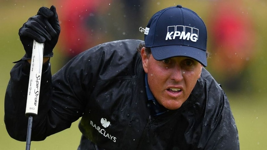 US golfer Phil Mickelson lines up a putt on the 13th green during his second round on day two of the 2016 British Open Golf Championship at Royal Troon in Scotland on July 15, 2016. The second round got underway on Friday morning, with expectations for far more trying conditions at Royal Troon. / AFP / Ben STANSALL / RESTRICTED TO EDITORIAL USE (Photo credit should read BEN STANSALL/AFP/Getty Images)