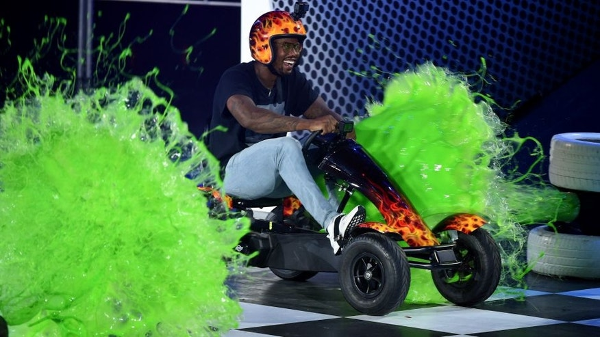 WESTWOOD, CA - JULY 14: NFL player Von Miller is slimed onstage during the Nickelodeon Kids' Choice Sports Awards 2016 at UCLA's Pauley Pavilion on July 14, 2016 in Westwood, California. (Photo by Kevin Winter/Getty Images)
