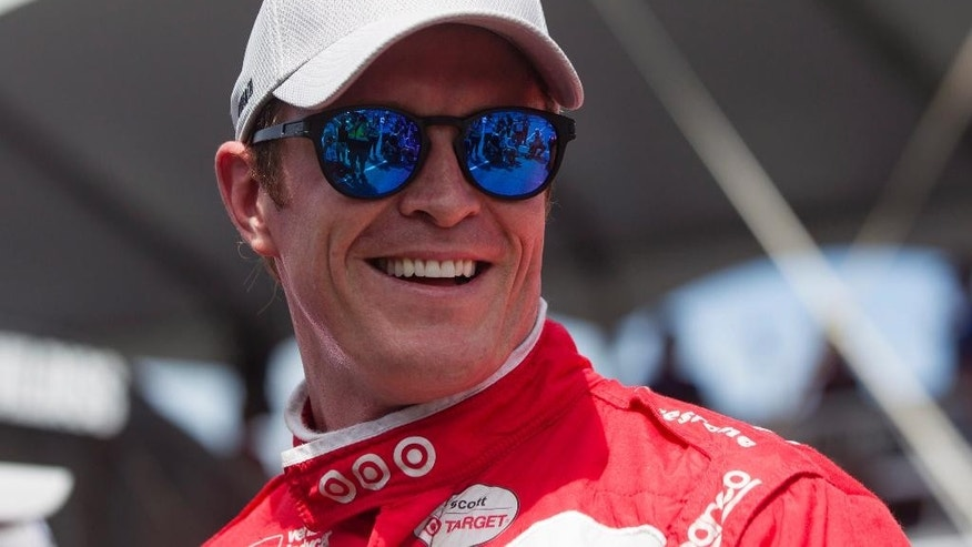 New Zealand's Scott Dixon smiles after winning the pole position during qualifying for the IndyCar auto race in Toronto on Saturday, July 16, 2016. (Chris Young/The Canadian Press via AP)