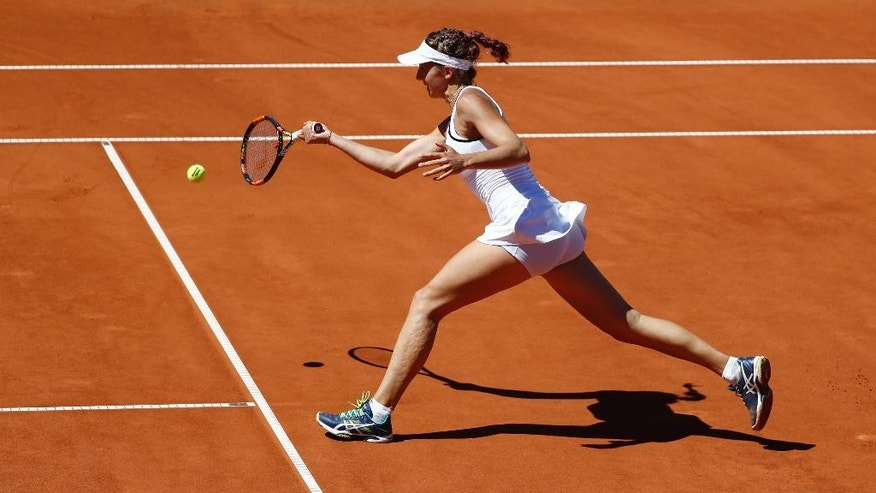 Rebeka Masarova of Switzerland returns a shot during her quarterfinal match against Annika Beck of Germany, at the WTA Ladies tennis tournament in Gstaad, Switzerland, Saturday, July 16, 2016.  (Peter Klaunzer/Keystone via AP)