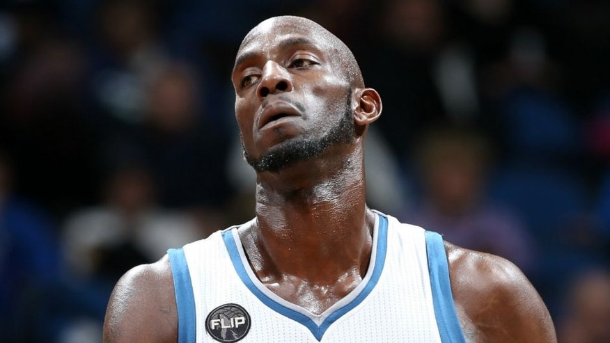 MINNEAPOLIS, MN - JANUARY 17: Kevin Garnett #21 of the Minnesota Timberwolves looks on during the game against the Phoenix Suns on January 17, 2016 at Target Center in Minneapolis, Minnesota. NOTE TO USER: User expressly acknowledges and agrees that, by downloading and or using this Photograph, user is consenting to the terms and conditions of the Getty Images License Agreement. Mandatory Copyright Notice: Copyright 2016 NBAE (Photo by David Sherman/NBAE via Getty Images)