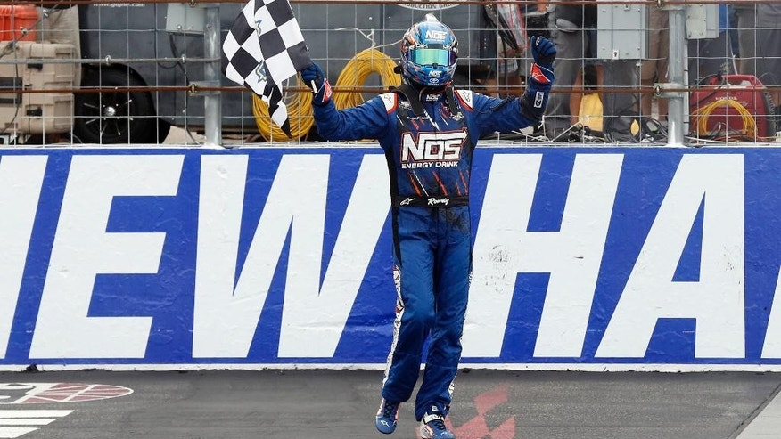 Kyle Busch celebrates after winning the NASCAR Xfinity auto race at New Hampshire Motor Speedway, Saturday, July 16, 2016, in Loudon, N.H. (AP Photo/Jim Cole)