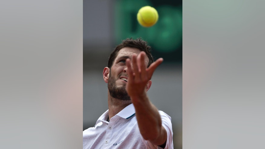 Britain's James Ward serves a ball to Serbia's Dusan Lajovic during their Davis Cup quarterfinal tennis match in Belgrade, Serbia, Saturday, July 16, 2016. (AP Photo/Marko Drobnjakovic)