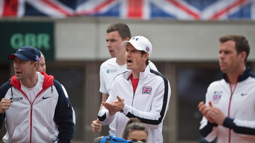 Britain's Andy Murray, center, shows support for the British Davis Cup team during their Davis Cup quarterfinal tennis match against Serbia in Belgrade, Serbia, Saturday, July 16, 2016. (AP Photo/Marko Drobnjakovic)