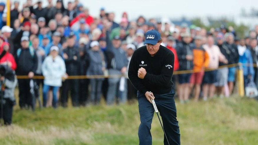 Phil Mickelson of the United States celebrates after making a birdie on the 13th green during the third round of the British Open Golf Championship at the Royal Troon Golf Club in Troon, Scotland, Saturday, July 16, 2016. (AP Photo/Ben Curtis)