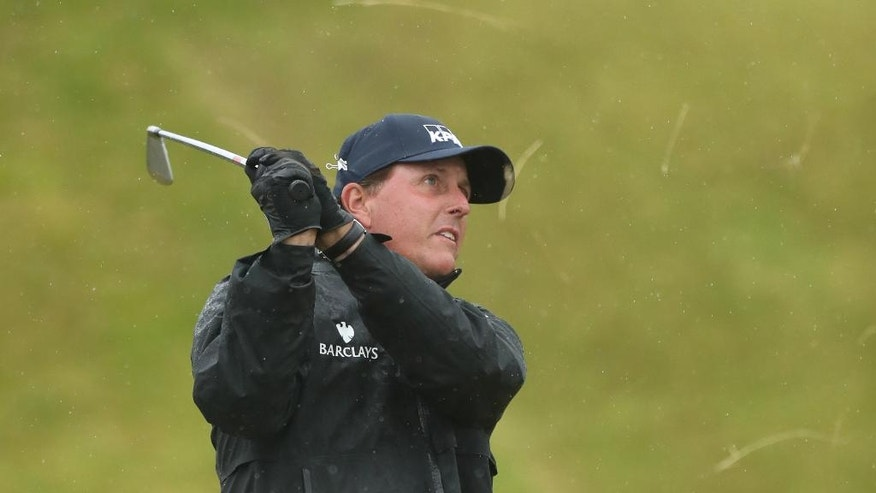Phil Mickelson of the United States plays a shot on the 14th fairway during the second round of the British Open Golf Championships at the Royal Troon Golf Club in Troon, Scotland, Friday, July 15, 2016. (AP Photo/Peter Morrison)