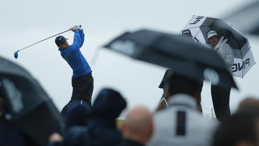 Rory McIlroy of Northern Ireland tees off the 13th hole watched by Bubba Watson of the United States, right, during the second round of the British Open Golf Championship at the Royal Troon Golf Club in Troon, Scotland, Friday, July 15, 2016. (AP Photo/Ben Curtis)